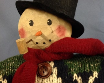 Hand carved wooden snowman with festive sweater,scarf and scrunched felt top hat.