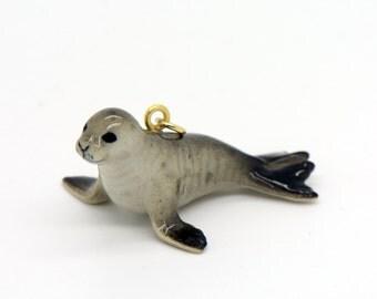 Sea lion pendant etsy 1 porcelain monk seal pendant hand painted glaze ceramic animal small ceramic sea lion bead mozeypictures Image collections