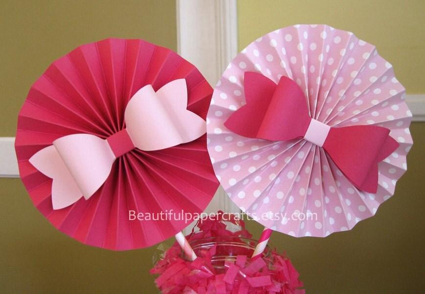 Pink bows rosettes centerpieces paper fans