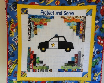 Protect and Serve.  Appliqued Police Car Baby Quilt,  Patchwork background highlights the Appliqued Patrol Car