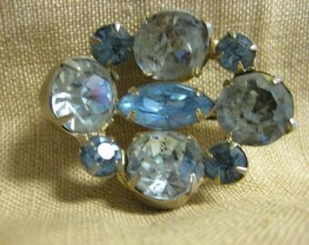Cute little multi-stone blue rhinestone brooch
