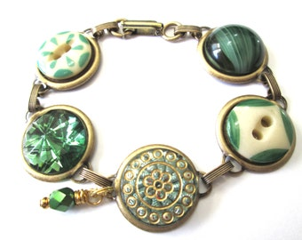 Antique button bracelet. GREENS. Amazing glass piece in center, antique china stencil buttons, glass buttons. One of a kind