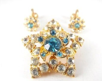Rhinestone Star Brooch Matching Earrings Vintage Costume Jewelry Set Blue and Clear Stones Lovely Pinwheel Design