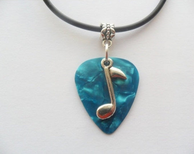 Turquoise Guitar pick necklace with music note charm and adjustable cord.