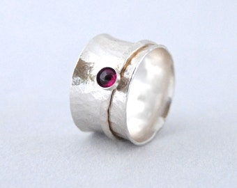 Garnet Spinner ring in textured sterling silver wide band - anticlastic ring - relaxation ring