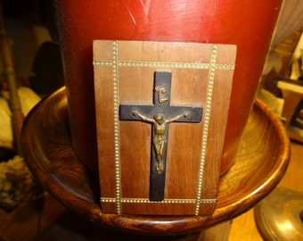 Little mounted cross on plaque with inlaid brass braiding
