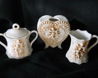 Lefton Bisque Collection, Creamer, Sugar with Lid, Heart-shaped Footed Vase, Cherubs