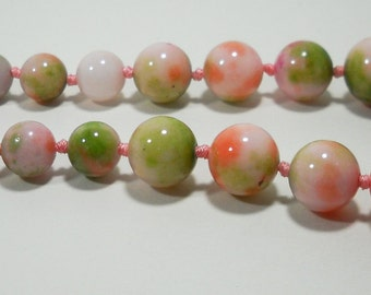 Light Red and Green Apple Splattered White Jade Round Graduating Bead Strand 8mm - 16mm