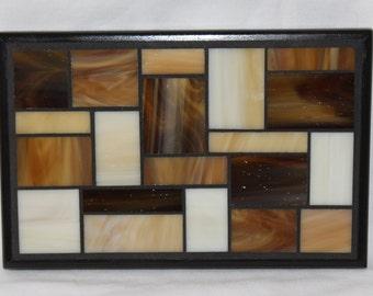 Brown glass mosaic trivet with black wood trim