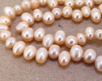 One Full Strand--- Luster Rice Pure Pink Freshwater Pearl----5mm-8mm----about  65Pieces----15.5 inch strand