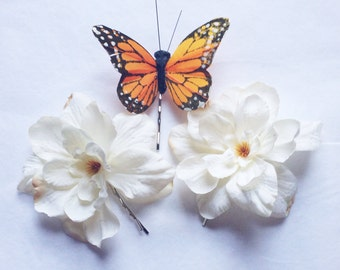 Orange monarch glen feather butterfly and white delphinium blossoms hair clip bobby pin set