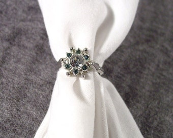 "Avon ""Starsong"" Silver Tone Ring with Rhinestone Center and Faux Sapphires - VIntage 1974"