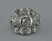 Genuine Art Deco platinum and 1.75 Ct diamond cocktail ring
