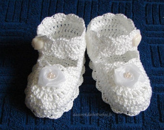 Crocheted baby girl christening shoes with flowers
