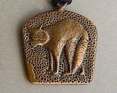 Hand-carved Raccoon pendant cast from brass bullet casings cleaned from Colorado Pawnee Grasslands National Park.