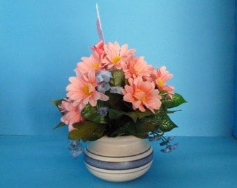 Floral Arrangement, A Wonderful Bouquet of Pink Daises and Blue Baby Breathes in a Pretty Ceramic Vase.