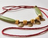 Colorful boho brass necklace, red cord, beads. Gypsy coin necklace.