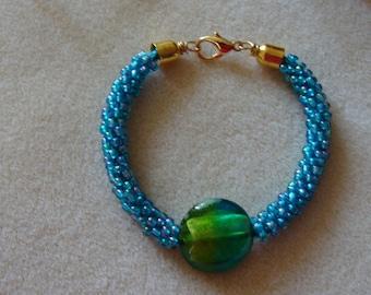 Kumihimo bracelet with Murano glass focal bead.