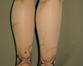 ball joint tights. broken old fashioned ball jointed doll tights joint