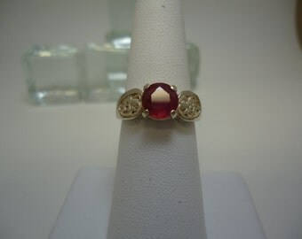 Round Cut Ruby Ring in Sterling Silver