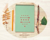 Notebook (Sketchbook) with a carved geometry native pattern