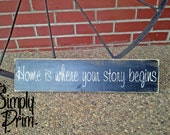 "Sign ""Home is where your story begins"""