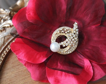 Beautiful  gold   color   brooch with sparkling rhinestones
