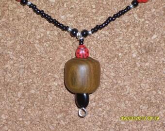 Ladybug In Lignum Vitae Wood Bead Pendant Necklace