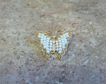 Lovely Lisner Butterfly brooch with gold tone metal and faux pearls