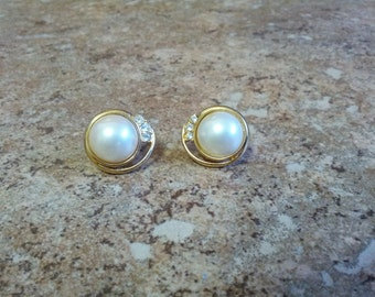 Beautiful clip on earrings with shiny gold tone metal, faux pearl and rhinestones