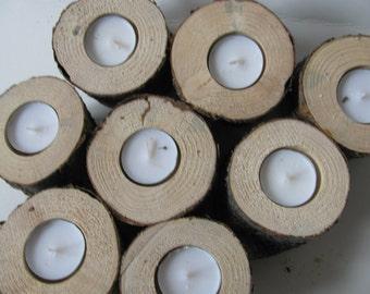 Seven pine wood candle holders. Rustic wedding tree log tea lights.
