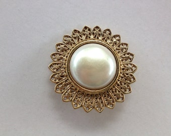 Filigree white sun brooch