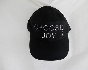 "Rhinestone Baseball Hat, ""Choose Joy"" in Black. Saying Is Done In All Clear Bright Rhinestones With A Removable Letter J Charm"
