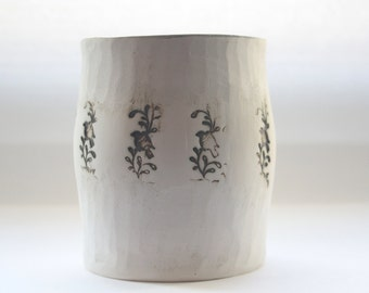 Earthenware vessel handthrown with an aged look and embossed birds on branches