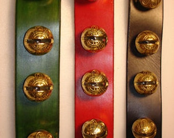 Brass Sleigh Bells (4) on a leather strap