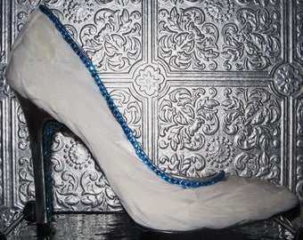 white feathered silver stiletto heels with turquoise rhinestones and glittered soles