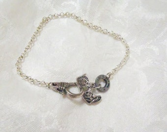 Cowboys and Handcuffs Western style bracelet (or anklet) - antiqued silver cowboy boot charm, hand cuff style clasp and ammo casing