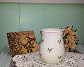 Small ceramic vase with rosebuds