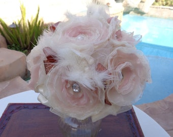 Bridal bouquet in hand made flowers in ivory and blush