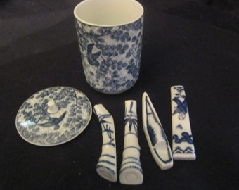 "Vintage Asian Blue white Porcelain lidded jar with porcelain pieces 4""tal  2""diameter Mint"