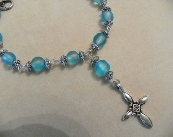 Handmade Decade Rosary Bracelet made with light blue glass beads and metal cross