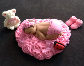 Fondant baby lying on a pink bed of roses cake topper for Baby Shower, Birthday, Party Favor