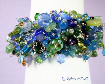 Ocean Waves- a  beadwoven bracelet featuring a collection of beautiful blue and green beads!