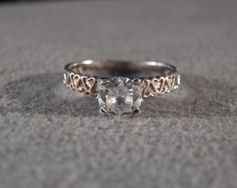 Vintage Sterling Silver Solitaire Style Ring with Large Round White Topaz and Cut-Away Hearts Decorating the Band, Size 9 1/2     M