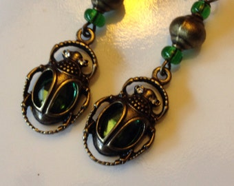 Scarab beetle earrings with brass, green beads