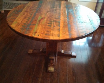 Reclaimed Barnwood Round Table With Colorful Character
