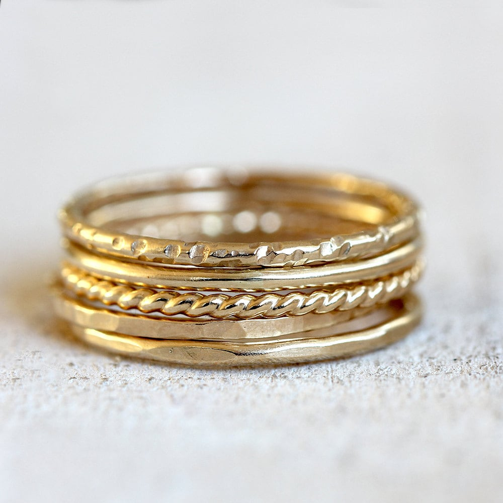 A fresh take on a classic ring stack, this hand-picked stack of masterfully crafted solid yellow gold bands are as chic as they are versatile. Wear the stack as shown or mix it up yourself for a special touch.