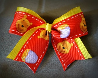3 inch mini cheer bow made with Winnie the Pooh ribbon, alligator clip, pooh, honey, red, yellow