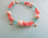 Beachy Jewelry/Coral Bracelet /Seafoam Green Czech Glass /Gold Filled Starfish Charms /White Wood Beads / Sea Inspired Jewelry