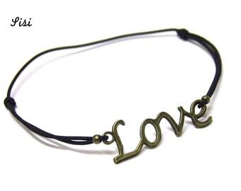 "Bracelet ""Love"" on black elastic cord"